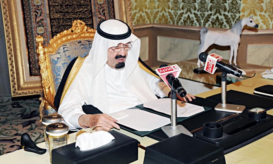 Saudi King Abdullah addresses the nation from his office at the Royal Palace in Riyadh