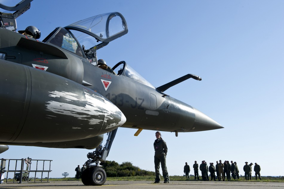 A French Air Force Mirage 2000 jet make preparations at the Solenzara military air base before a mission over Libya