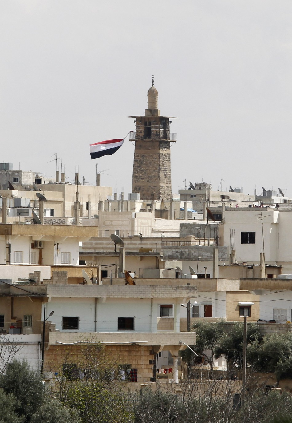 A Syrian flag flutters from the minaret of Omari mosque at the old city of Deraa March 22, 2011.