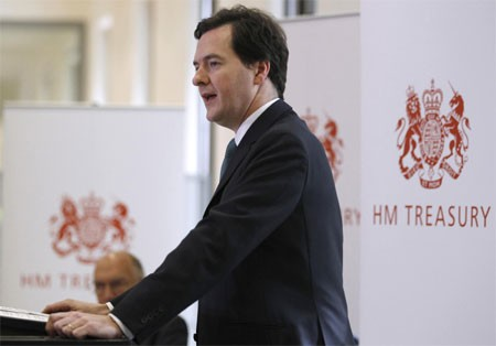Chancellor George Osborne, arrives to speak at a news conference at the Treasury, in central London