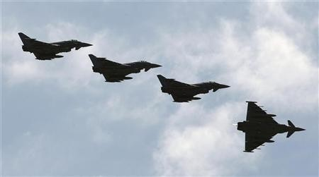 Four Italian Air Force Eurofighter EF-2000 Typhoon fly over the Birgi NATO Airbase in Trapani