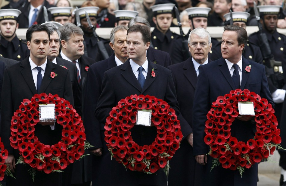 Britain's Prime David Cameron, Deputy Prime Minister Nick Clegg and opposition Labour Party leader Ed Miliband attend the annual Remembrance Sunday ceremony in central London