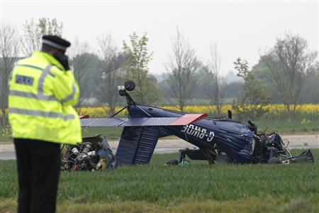 Investigators inspect a light aircraft that crashed with MEP for the UK Independence Party Farage on board at Hinton in the Hedges Airfield in Steane