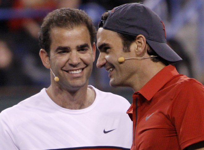 Federer and Sampras smile as they play against Agassi and Nadal during their doubles exhibition doubles in the Hit for Haiti fund raiser event at the Indian Wells.