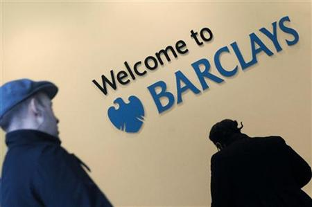 Customers enter a branch of Barclays bank in the City of London