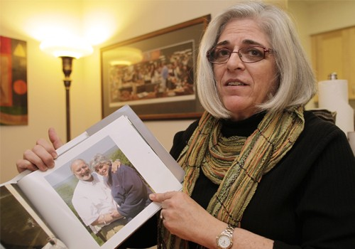 Judy Gross, wife of U.S. aid contractor Alan Gross who is jailed in Cuba, shows their family picture during an interview with Reuters at her apartment in Washington October 23, 2010