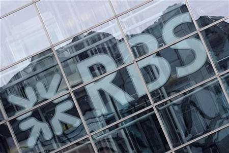 Buildings are reflected in the windows of the offices of the Royal Bank of Scotland (RBS) in the city of London