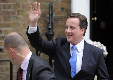 The leader of Britain's opposition Conservative Party David Cameron leaves after making a statement at St Stephens Club in central London, May 7, 2010