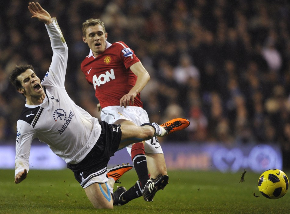 Fletcher of Manchester United tackles Bale of Tottenham Hotspur during their English Premier League soccer match in London.