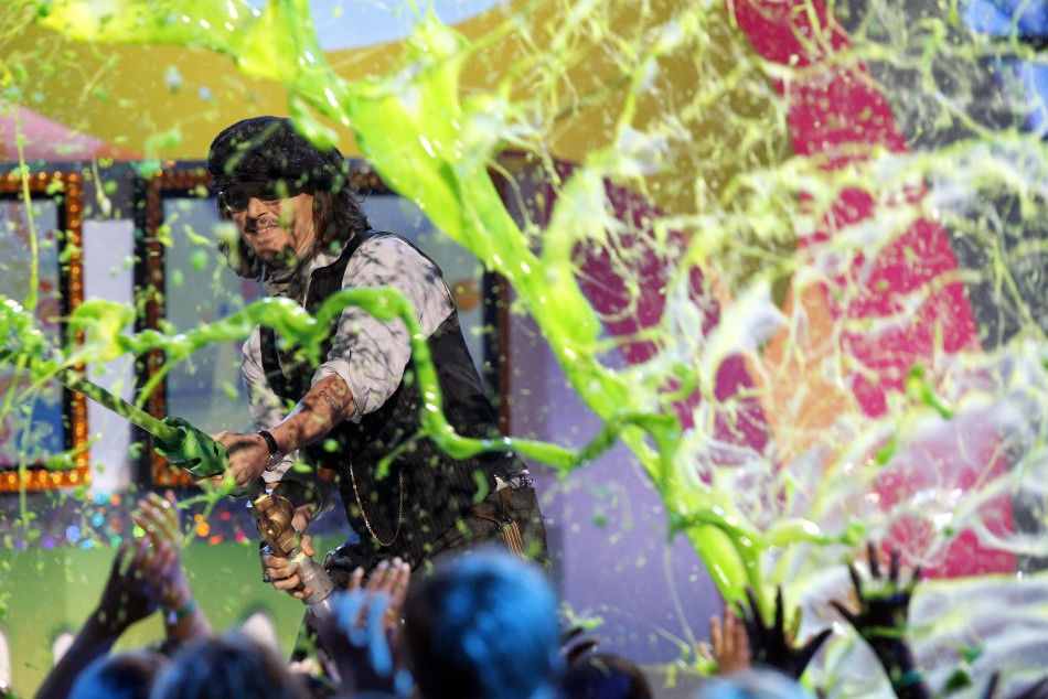 Depp, recipient of the Favorite Movie Actor award, slimes members of the audience at the 24th annual Nickelodeon Kids Choice Awards in Los Angeles