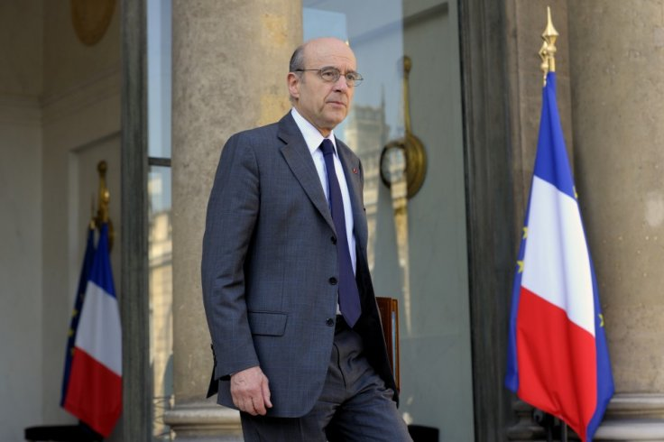 France's Foreign Affairs Minister Juppe leaves the Elysee Palace in Paris