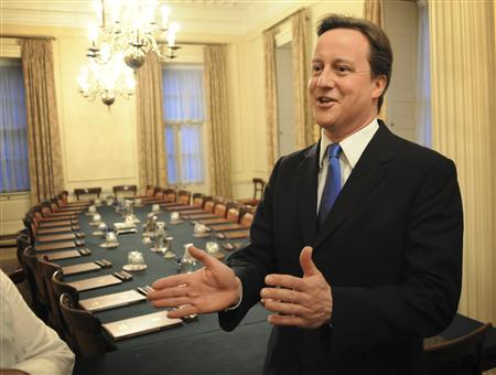 Britain's incoming Prime Minister David Cameron stands in the Cabinet Room inside 10 Downing Street in London