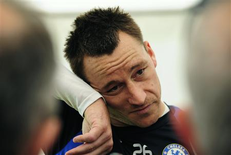 Chelsea's John Terry talks to journalists during a media day at their training ground in Cobham