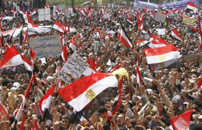 Protesters wave Egyptian flags during a protest in Tahrir square, Cairo, April 8, 2011. Tens of thousands of Egyptians protested in Cairo on Friday to press demands including the prosecution of Hosni Mubarak, voicing frustration with the military for bein