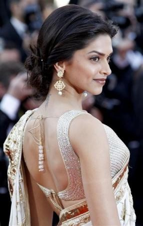 """Actress Deepika Padukone arrives on the red carpet for the screening of """"Tournee"""" by director Mathieu Amalric at the 63rd Cannes Film Festival"""