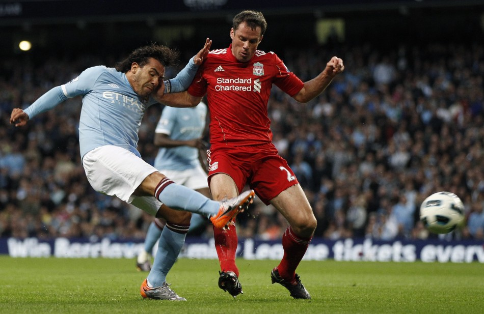 Manchester City's Tevez shoots at goal past Liverpool's Carragher during their English Premier League soccer match at the City of Manchester stadium in Manchester.