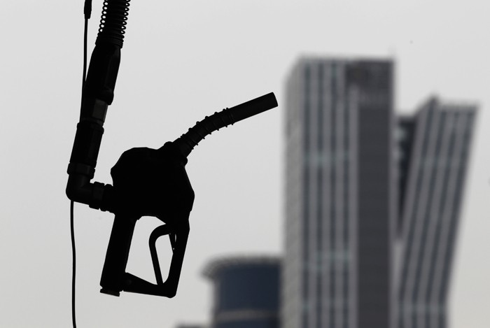 A gasoline pump is seen hanging at a petrol station in central Seoul