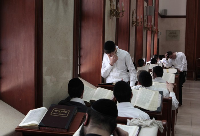 Ultra-Orthodox Jewish youths study religious texts at a synagogue in Jerusalem April 7, 2011
