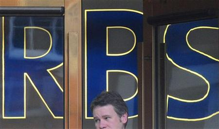 A man leaves a branch of the Royal Bank of Scotland (RBS) in the city of London