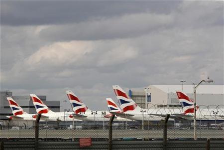 British Airways aircrafts sit parked at Heathrow airport
