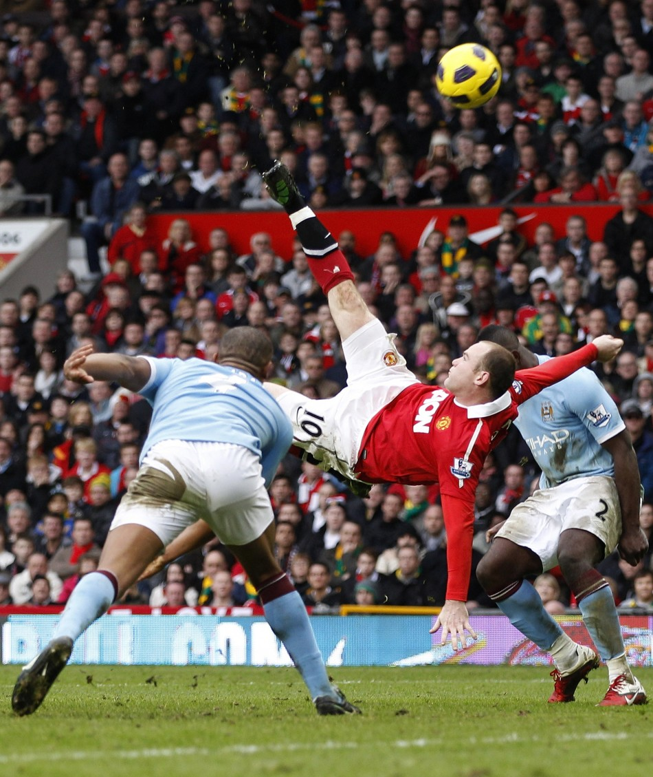 Manchester United's Wayne Rooney scores against Manchester City from an overhead kick during their English Premier League soccer match at Old Trafford in Manchester.