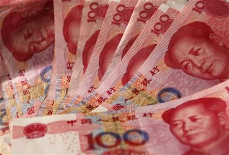 "Yuan banknotes are seen in this picture illustration taken in BeijingU.S. needs to ""take a look"" at China yuan action: Sen. Reid"