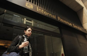 A woman walks out of an Internal Revenue Service office in New York April 18, 2011.