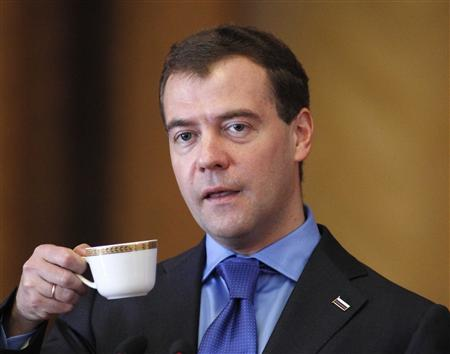 Russia's President Medvedev holds a cup while addressing the audience during his visit to Taras Shevchenko National University in Kiev