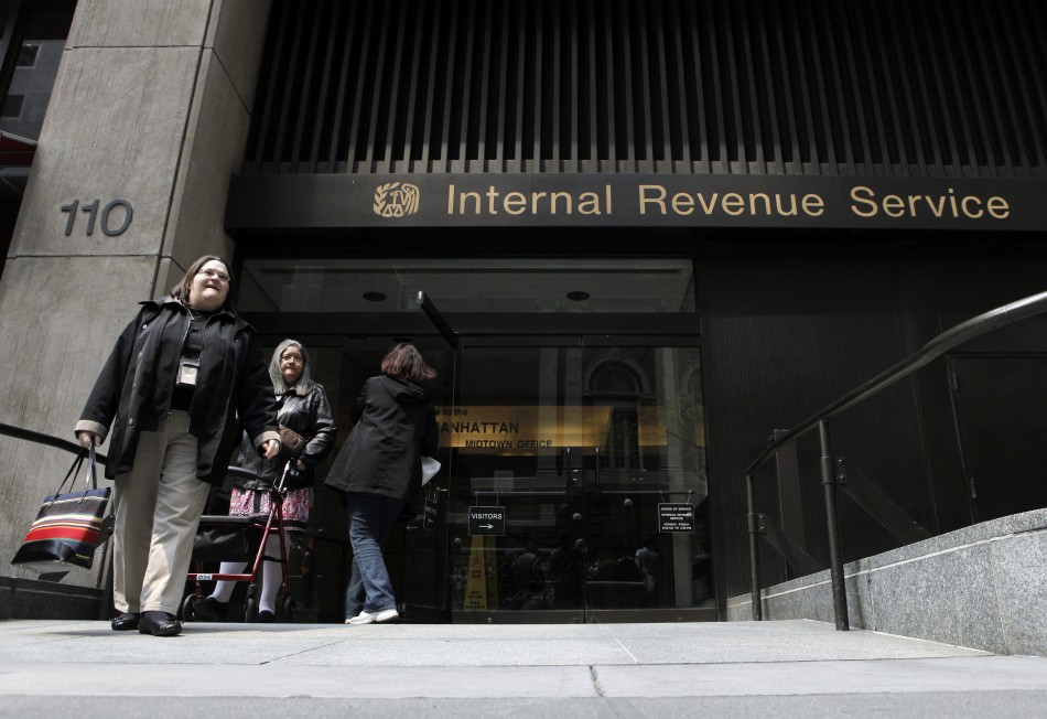 Women walk out of an Internal Revenue Service office in New York April 18, 2011.
