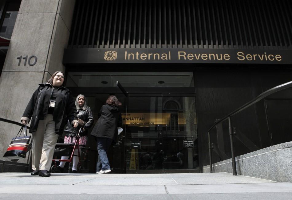 Women walk out of an Internal Revenue Service office in New York April 18, 2011.