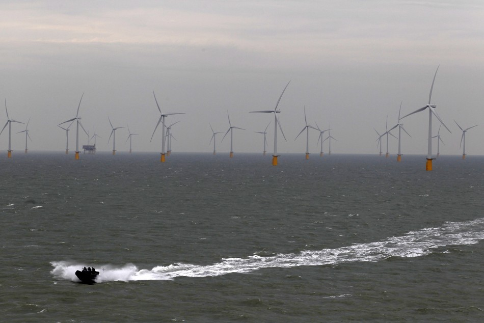 A boat powers past the Thanet Offshore Wind Farm off the Kent coast in southern England September 23, 2010