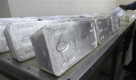 A worker stores ingots of 99.99 percent pure silver, which weigh 30 kilos (66 lbs), to pack them at the Krastsvetmet nonferrous metals plant in Russia's Siberian city of Krasnoyarsk.