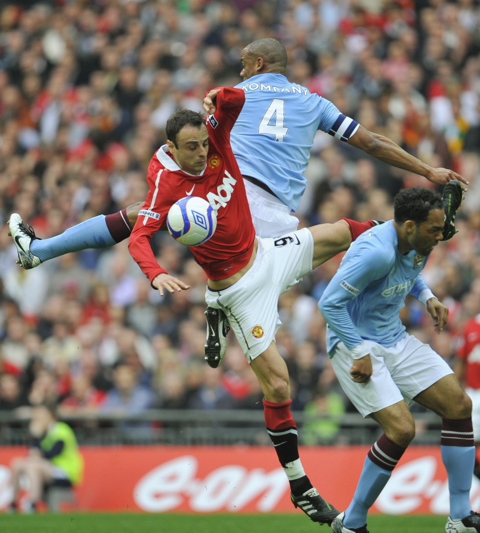 Manchester City's Vincent Kompany and Joleon Lescott challenge Manchester United's Dimitar Berbatov for the ball during their FA Cup semi-final soccer match in London