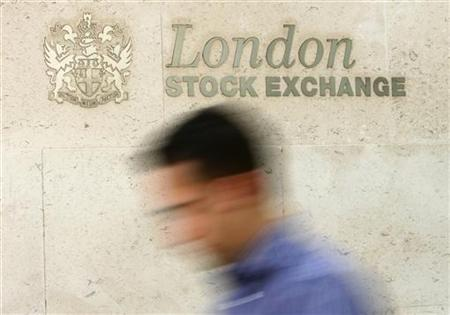 A man passes the London Stock Exchange in central London