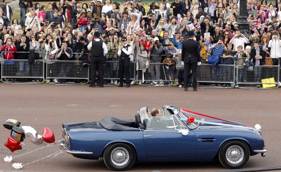 Prince William and his wife Catherine, Duchess of Cambridge drive from Buckingham Palace in an Aston Martin DB6 Mark 2.