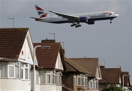 A British Airways plane lands over homes near Heathrow Airport in London