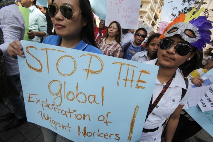 Migrant workers hold placards during a demonstration to support the rights of migrant domestic workers on International Workers' Day or May Day, in Beirut