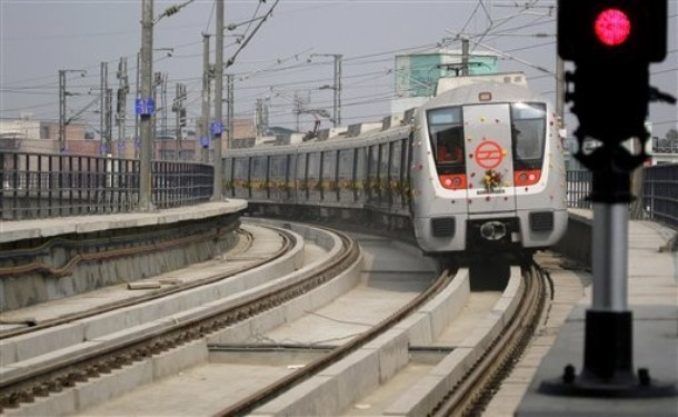 A Delhi Metro Rail Corporation (DMRC) train runs on its tracks after being flagged off for its trial run in Gurgaon, India, Friday, Jan. 29, 2010. The DMRC conducted its first trial run of the under-construction 27 kilometers (17 miles) long Central Secre