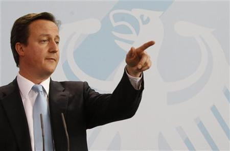 British Prime Minister Cameron addresses media in Berlin