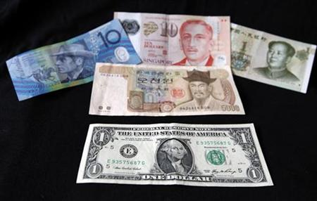 A US dollar note is pictured alongside other currencies in this picture illustration taken in Washington