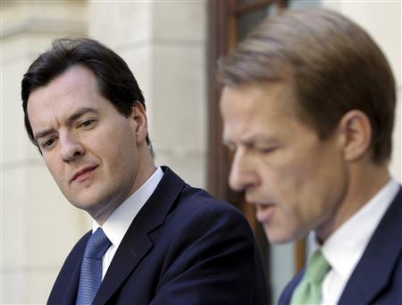 Chancellor George Osborne, and Chief Secretary to the Treasury, Laws, attend a news conference in central London