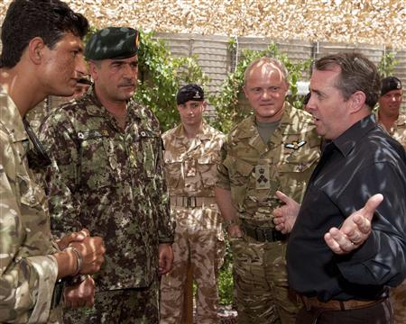 Defence Secretary, Fox, talks to troops during a visit to Lashkar Gah in Afghanistan