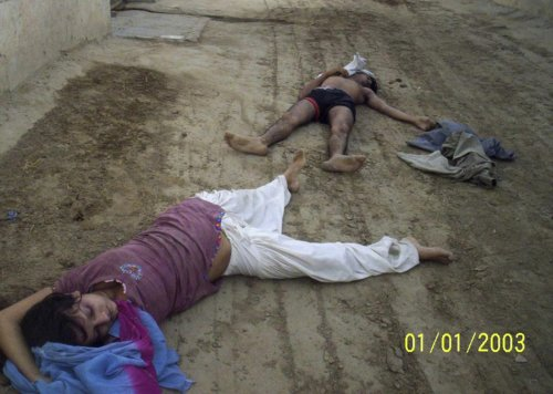 "The bodies of Sunita Devi (L), 21, and her partner Jasbir Singh, 22, lie on the ground after they were killed by villagers in an ""honour killing"" in Ballah village in the northern Indian state of Haryana"
