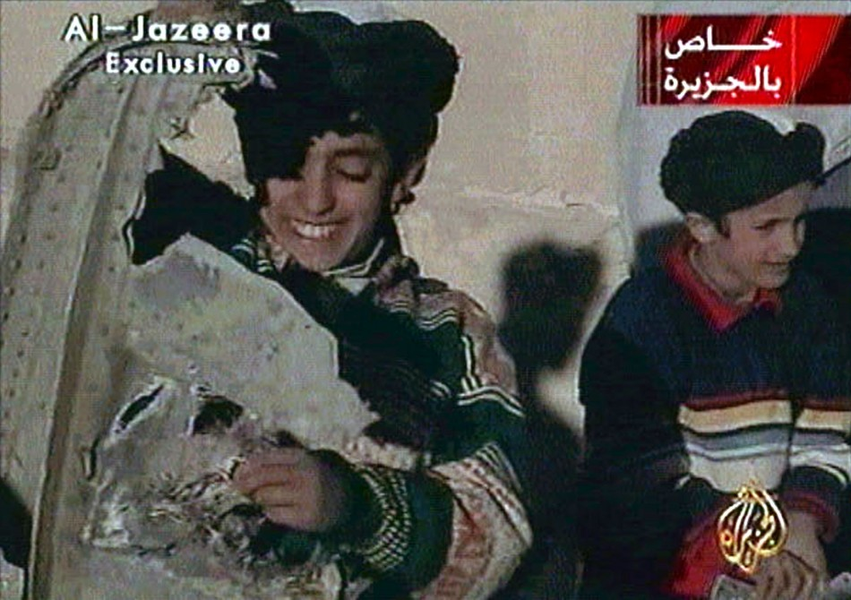 Picture taken from undated Al Jazeera television footage purportedly shows Hamza bin Osama bin Laden (L), one of the sons of Saudi-born dissident Osama bin Laden, displaying what the Taliban say is wreckage from a U.S. helicopter near Ghazni. Child at rig