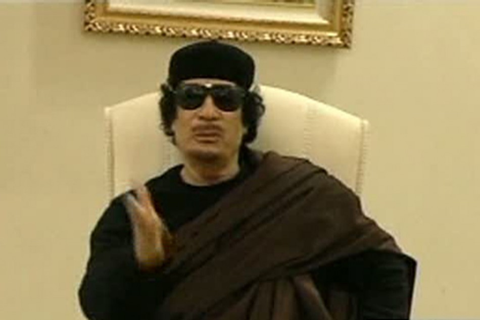 Still image from a video shows Gaddafi gesturing as he speaks at a Tripoli hotel