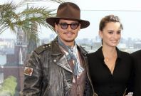 Actors Depp and Cruz pose for photographers in front of the Kremlin during a news conference in Moscow