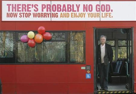 British author Richard Dawkins stands on a bus at the launch of an atheist advertising campaign in London