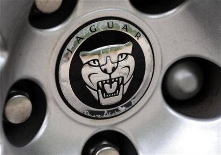 A Jaguar car logo is seen on a vehicle hubcap in central London