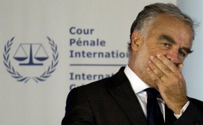 ICC chief prosecutor Luis Moreno-Ocampo listens to questions at a news conference in The Hague