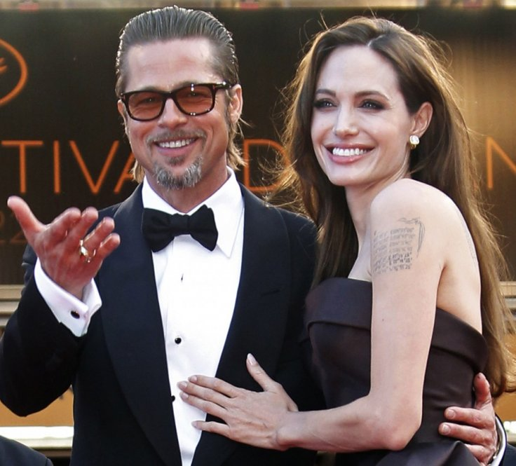 Angelina Jolie as she arrives with cast member Brad Pitt on the red carpe